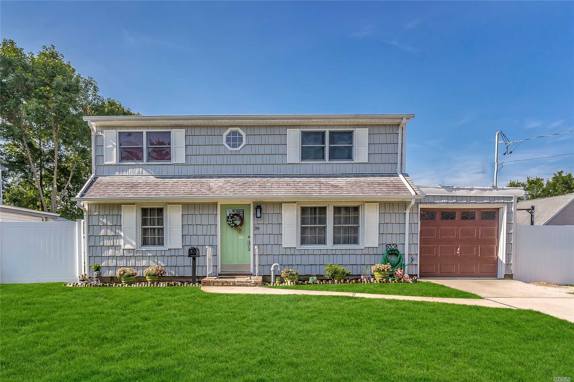 Beautiful Expanded Cape With Living Room, Formal Dining Room, Eat-In-Kitchen With New Stainless Steel Appliances, Sunroom, Updated Bath, In-Ground Sprinklers, And Much Much More.