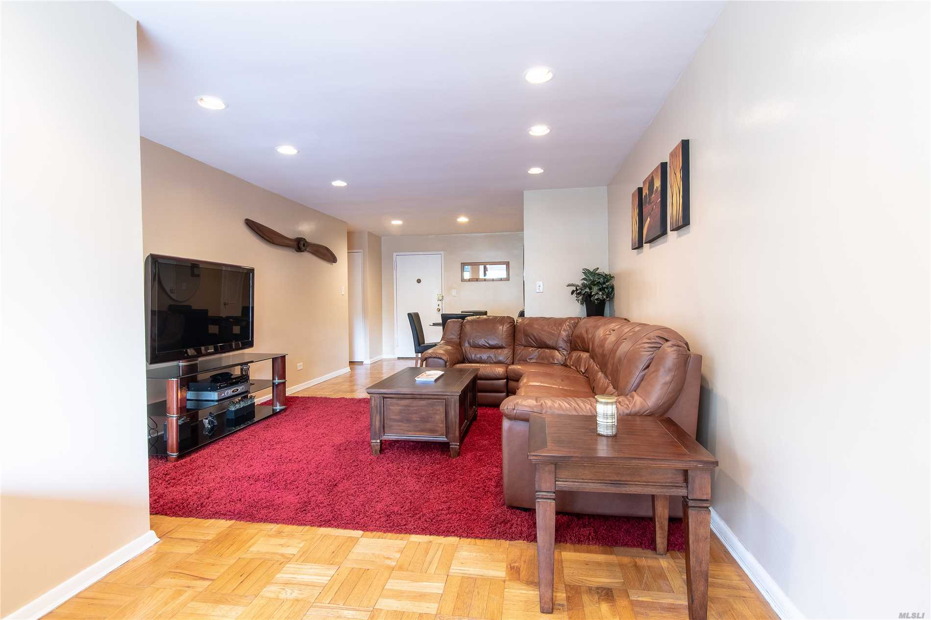Spacious Sun-Drenched Apartment With Laundry In The Unit. Come Live In Prestigious Section Of Bayside Terrace. Super Convenient With Your Own Parking Spot, Numerous Bus Lines, Fastest Lirr Train Line, Community Pool, Playgrounds, And Convenience To A Lively Town Filled With Restaurants, Movies, And Shopping. This Well Maintained Apartment Has Abundance Of Storage And Offers Two Bedrooms With Great Schools. Low Maintenance Includes The Parking And Laundry That Comes With The Apartment