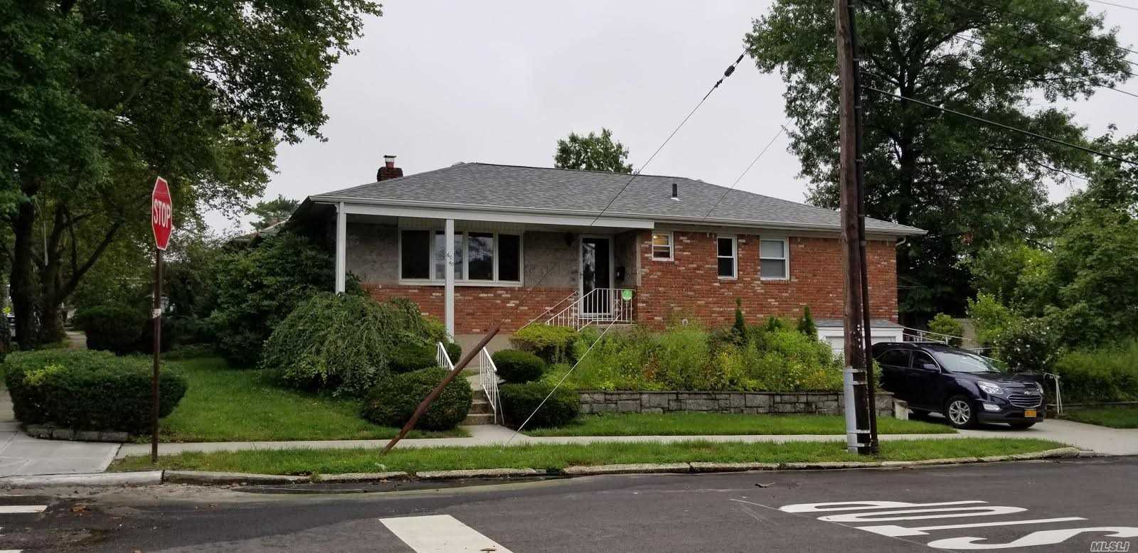 Beautiful Brick Ranch Home In The Little Neck Area. Updated Eik W/ Granite Counter-Top & Stainless Steel Appliances,  Hardwood Floors , Finished Basement, Near Public Transportation.