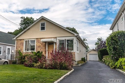 Beautiful, Cozy House With A Tremendous Driveway And Quiet Backyard And Block. Gorgeous Hardwood Floors Throughout With A Large Kitchen And Dining Room, Perfect For Hosting Any Occasion! 2 Awesome Size Bedrooms With A Full Finished Basement Containing Extremely High Ceilings.