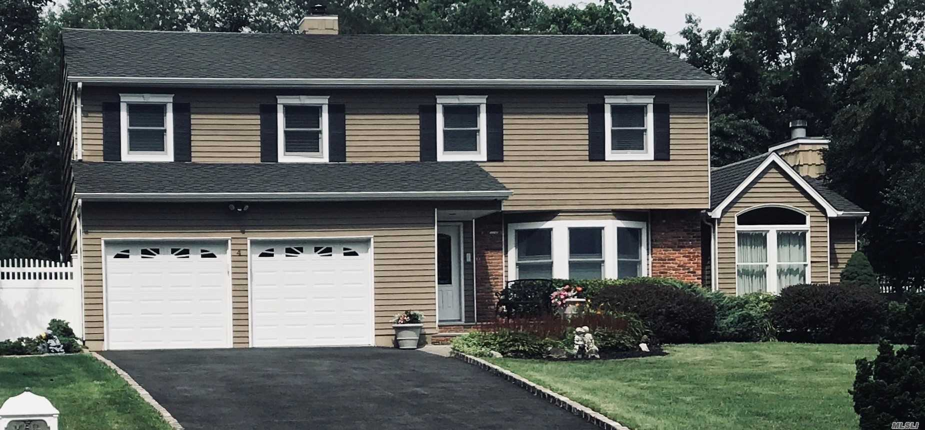Exp Island Estates 4 Bdrm, 2.5 Bath Colonial, 2 Car Gar.Quiet Cul De Sac On Lake Grove/Centereach Border. Private, Spectacular Backyard, O'sized Cedar Deck, Lagoon Style Builtin Pool W Waterfall And Diving Rock, Techo Block Pavers. Driveway(2017), .Certainteed Landmark Architectural Roofing(2005), Peerless Boiler And Water Htr(2009)(4 Zone Heating), Lennox A/C (2) 3.5 Ton Units(2015), Fin Basement With 9'Ceiling + Friedrich Split A/C, Wood Burning Fire Place W Conversion Option, Updated Security Sys.