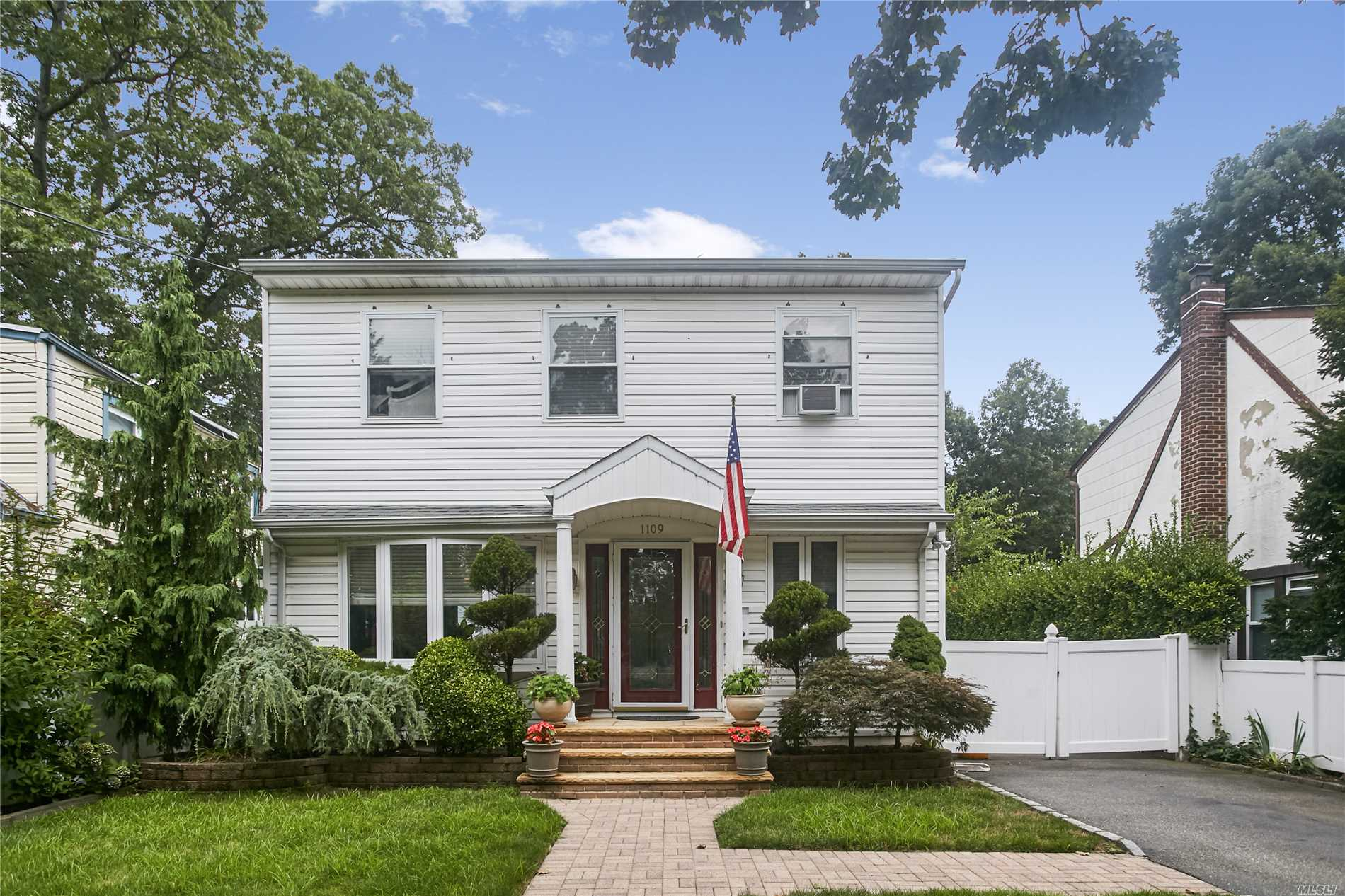 Beautifully Updated 4 Bedroom Home, Large Updated Eat-In-Kitchen, Updated Baths, Jacuzzi Bath,  Full Finished Basement, Hard Wood Floors Through Out,