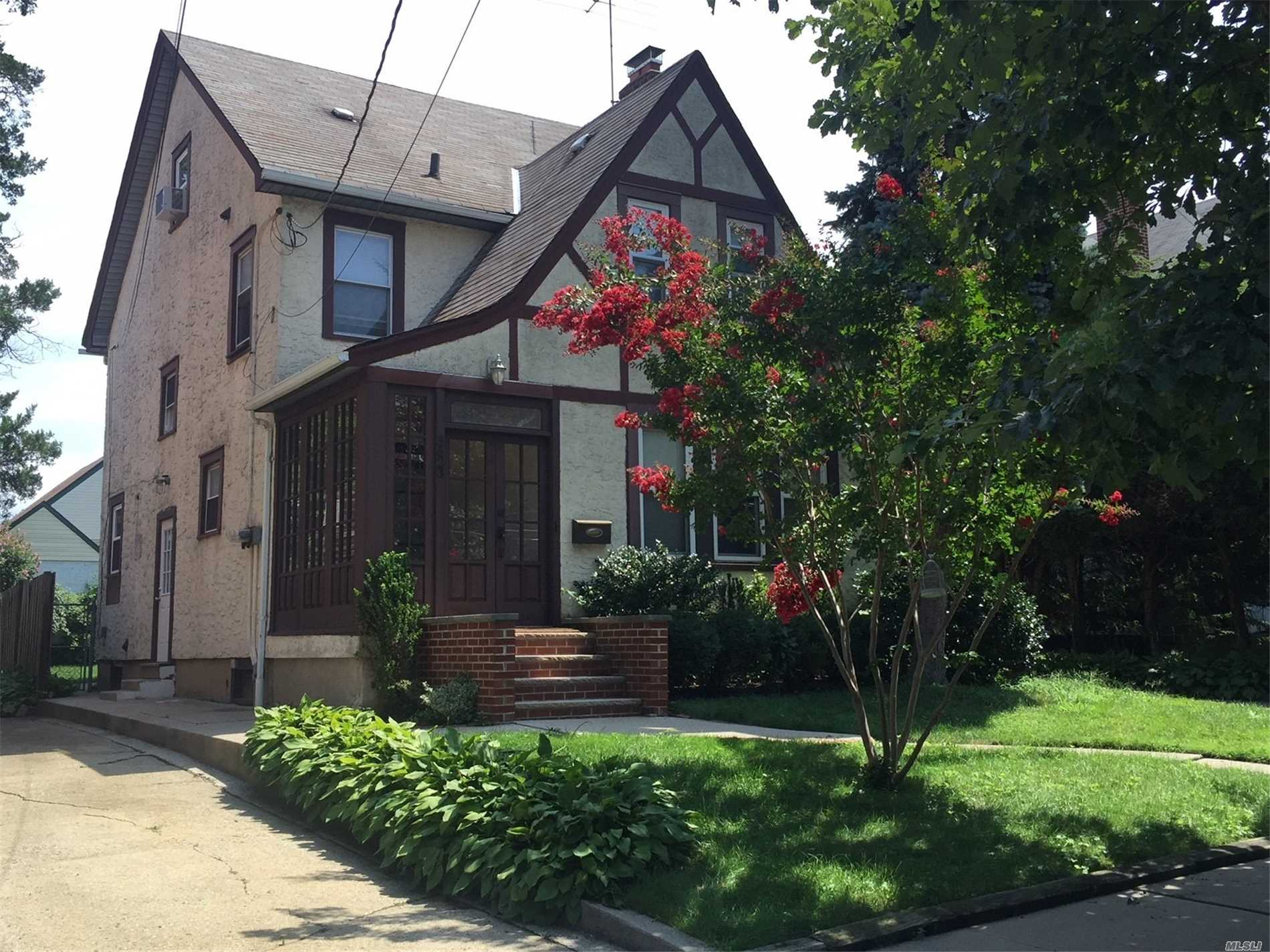 First Floor Apartment In 2-Family Tudor. Separate Entrance. W/D In Unit. Heat And Water Included. Quiet Street With Ample Parking. Convenient To Shopping And Transportation. Driveway Parking And Garage Storage Available.
