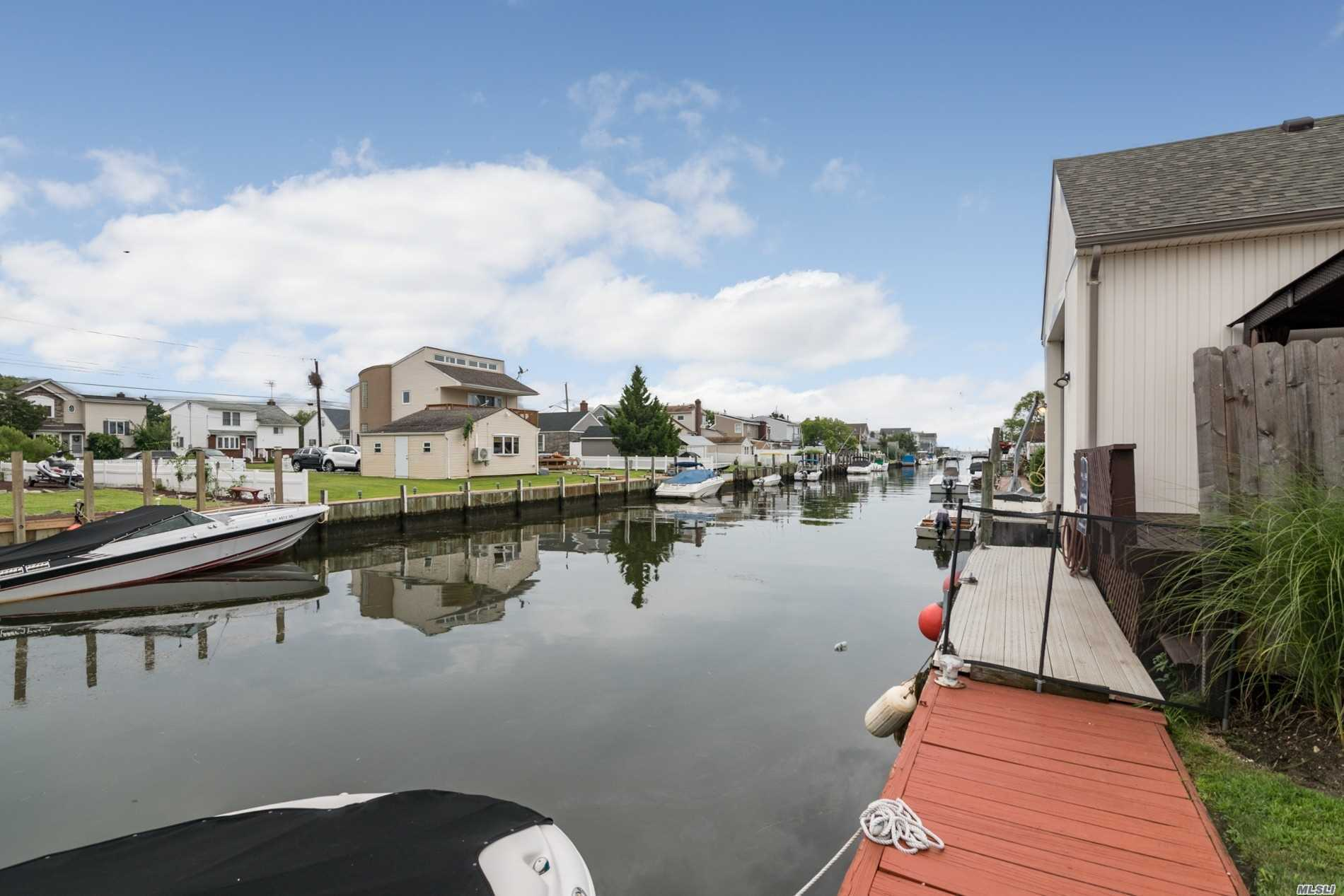 Waterfront Property 80 Feet Bulkhead Beautiful Vacation Setting Yard Home Is Completely Renovated Low Maintenance Efficient Easy Conversion For Mom To Stay Separately Minutes By Boat To All Local Beaches And Nightlife