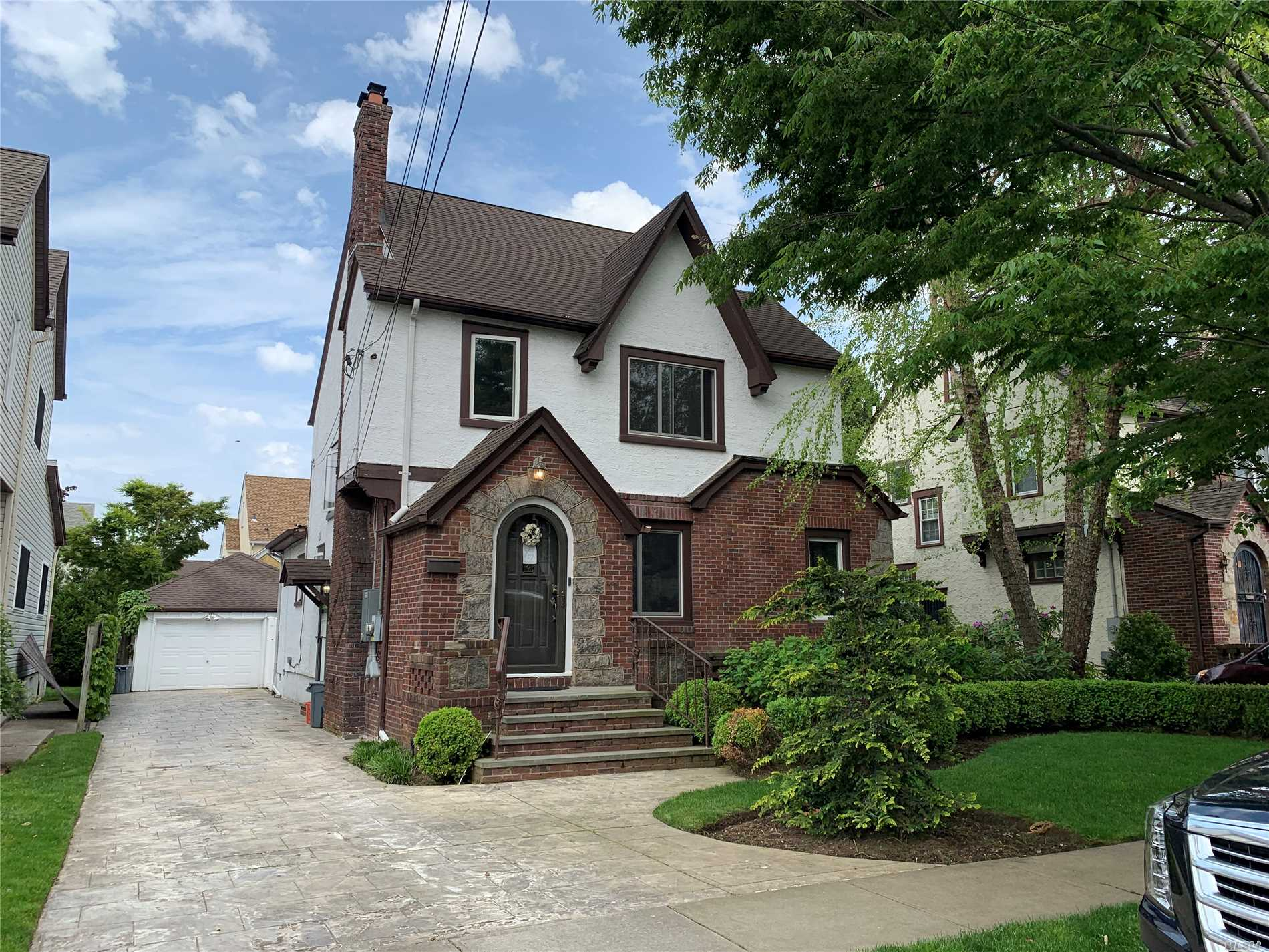 Diamond, 4 Br Tudor With Ig Pool W/ Solar Heat! Radiant Heat Under Hardwood Floors On Entire First Floor, New Wood Kitchen With Hi End Appliances. New Bathrooms, Doors, Boiler, Hw, Fireplace, Windows, Cac., Driveway, Pavers. Insulation Blown Into Walls And Attic. Security System W/ Cameras & Remote Locks. Motorized Awning In Rear, New Whole Home Gas Generator. Igs., California Closets, Window Treatments, And Much More