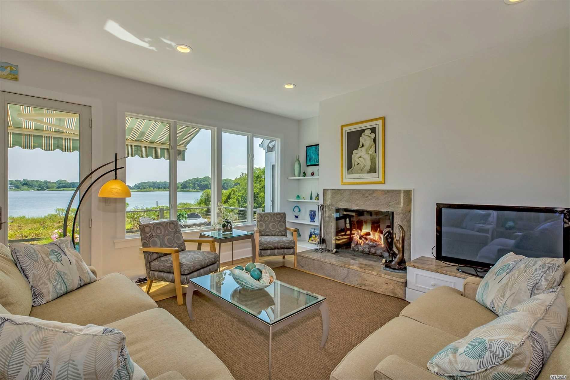 Most Marvelous Light & Bright Nantucket Style Waterfront Home With Private Dock! Beautifully Sited-Every Room Has Waterviews! Over 3500 Sq Ft, High Ceilings, Open Plan - Modern Kitchen & Baths. 1st Flr Master W/Fireplace & Direct Access To Deck And Waterfront. Two Ensuite Bedrooms - Four Bedrooms, 3.5 Baths In All. Great Rm W/Fireplace, Family Rm, Hobby Rm/Den. Al Fresco Dining, Lounging, Spa, Fire Pit, Outdoor Shower. Enjoy Boating, Kayaking & Swimming From Your Back Yard! Easy Walk To Town!