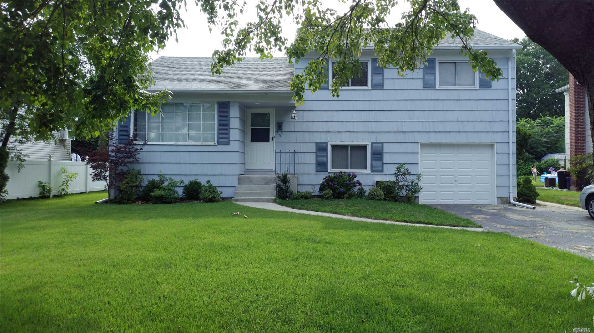 A Split Level Home On A Lovely Large Lot In East Williston School District.
