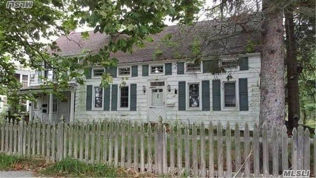 :Co Zoning Compliance For 3 Families. Located In Historic District Zoning. All Improvements Must Be Approved By Town, West Side Of Town On Main St., Built In 1800'S. Needs Tlc. Motivated Seller. Sold As Is. Do Not Walk Property