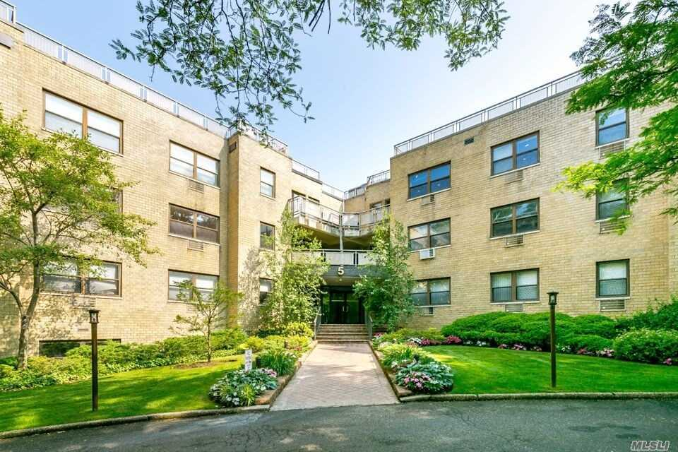 Location, Location, Location !! Renovated Apartment , Beautiful Hardwood Floors , New Bathrooms & Kitchen W/ Granite Counter Top , Lots Of Closets. Nice Balcony , Indoor Parking , Washer & Dryers On Floor, Beautiful Lobby Walking Distance To Train . Shops & Restaurants , Low Maintenance