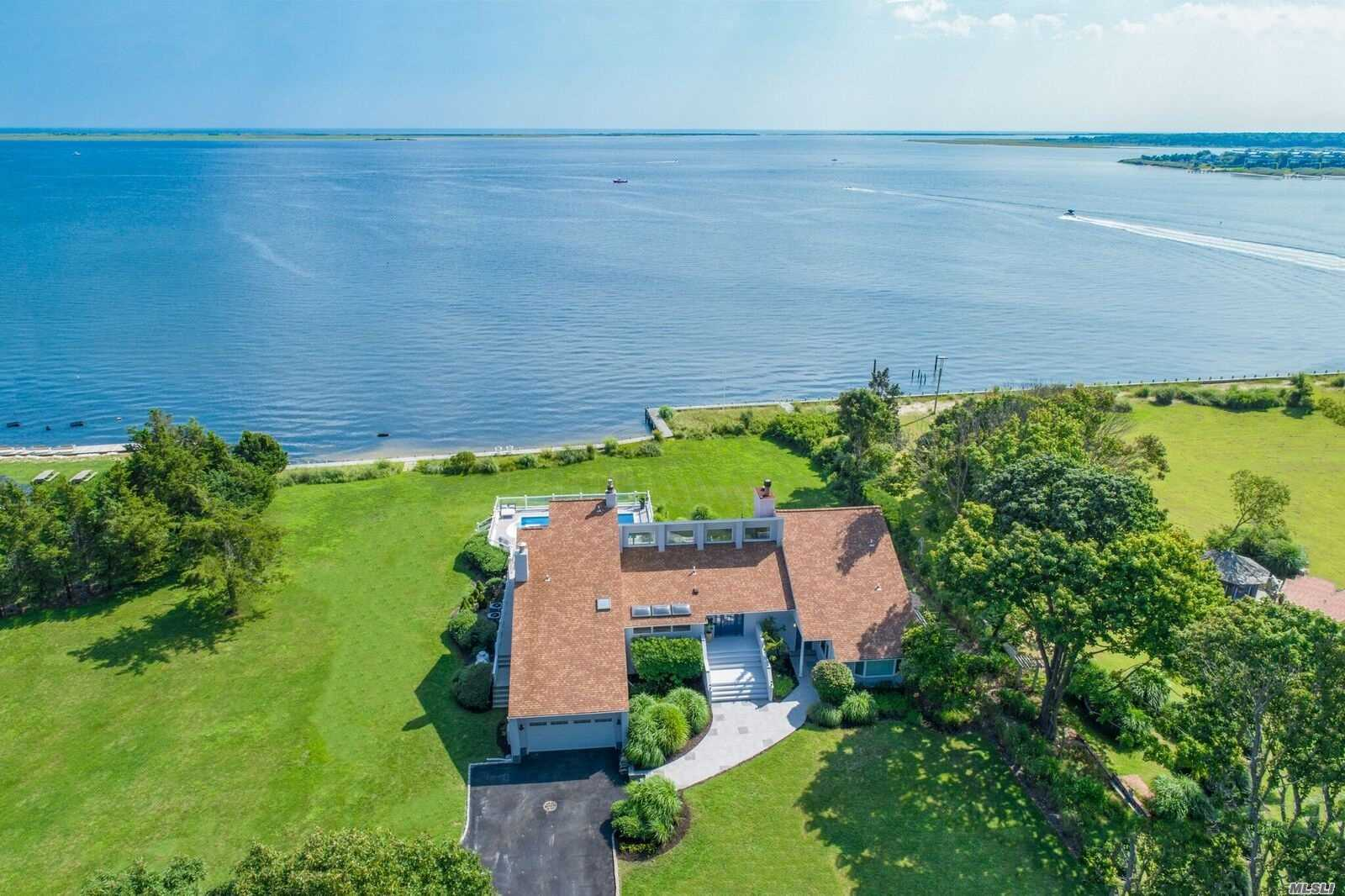 Newly Renovated 6, 000 Sqft Bayfront Designer Summer Getaway! Perflectly Sited On 1.07 Pristine Bayfront Acres Offering Endless Wide Open Views Of Moriches Bay . A True Boaters Paradise, Fully Bulkheaded , Boasting All New Modern Open And Luxurious Living Spaces Ideal For Entertaining All Summer Long! Complete With 5 Beds Including A Private Master Suite With Balcony, Private Guest Suite Quarters Along With A 16 X32 Sunsoaked Heated Pool, 3 Fireplaces And Multiple Outdoor Entertaining Spaces!!