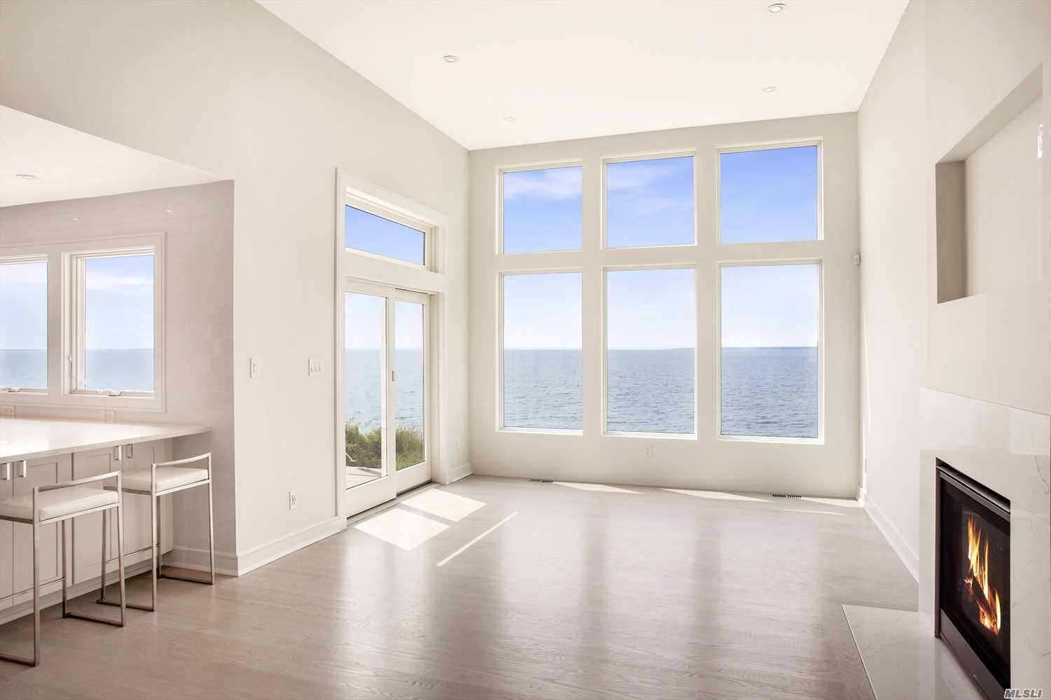 Once You Step Foot On This Newly Constructed Property You Will Be Enveloped In Modern Luxury With Endless Water Views Of The Bay And Ocean!! This 3 Bedroom Beach House Or Year Round House With Your Very Own Private Beach Offers Mesmerizing Sunset Views And Affords You Direct Access For Your Boat And Jet Skis. Quality Craftsmanship Inside And Out!! Built To Fema And Limwa Standards.  Truly A Dream Home!!