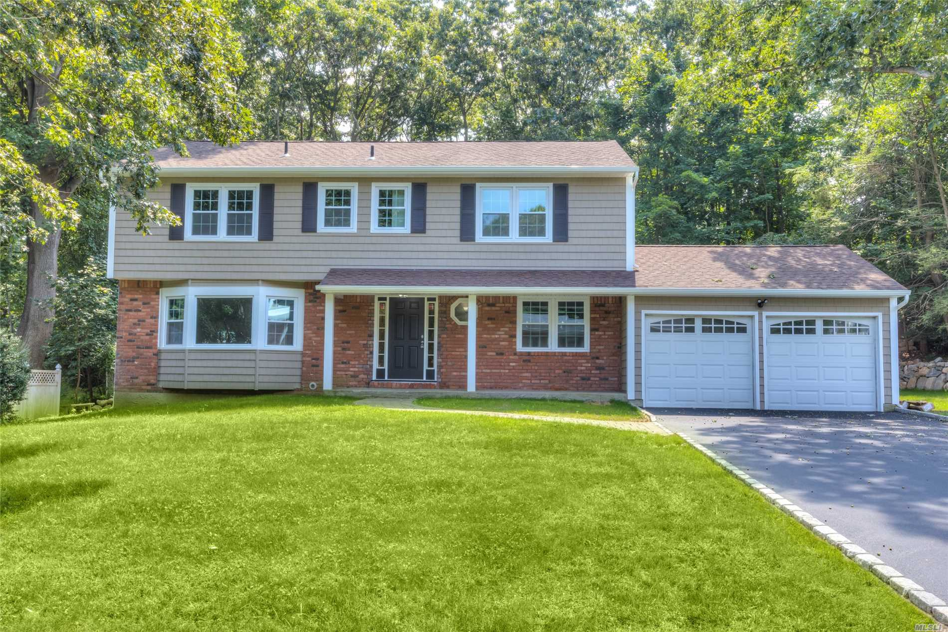 Just Renovated Aug 2017. New Siding, Windows, Driveway, Gleaming Hardwood Floors, New Kitchen, All New Baths, Just Move Right In!