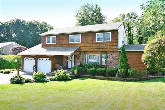 Well Maintained Expanded Colonial Located In A Wonderful Cul-De-Sac. Four Spacious
