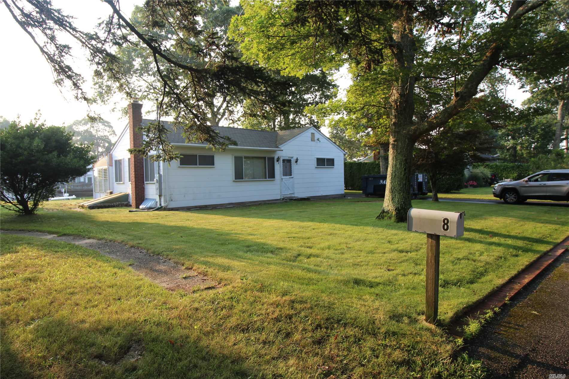 Canalfront Ranch In Shinnecock Shores Private Waterfront Community. House Built In 1956 Is In Poor Condition And Either Requires Complete Renovation Or Removal & Rebuild. House Has Nice Elevation & Is Not In Flood Zone. New 75' Vinyl Bulkhead Almost Completed. Floating Dock For Max. 35' Boat. Property Being Sold In As Is Condition. Current Footprint 1.456+-Sq.Ft,