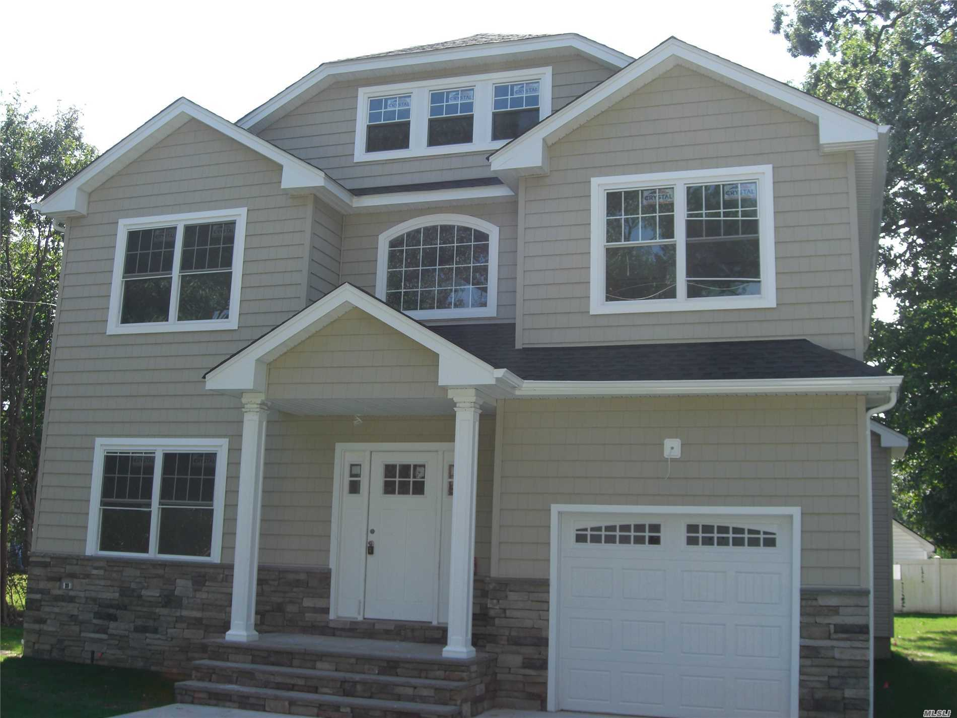 {New Construction}, 4 Huge Bedroom Colonial Including A Huge Master Suite, 2.5 Full Bath, Eat In Kitchen With Center Island, Quartz Counter Tops, Stainless Steel Appliances, Porcelain Tiles, Formal Living Room, Formal Dining Room And Family Room With State Of The Art Gleaming Hardwood Floors Through Out, Central Air Condition System, Gas Burning Fire Place, Laundry Room, Full Unfinished Basement With High Ceiling, Ose, 1 Car Attached Garage, Over Sized Yard With In Ground Automatic Sprinklers .