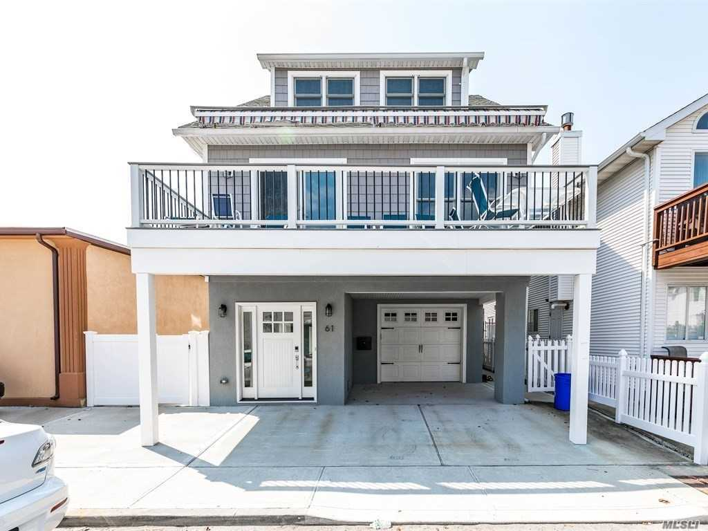 Beautifully Renovated And Recently Lifted Fema Compliant Home In The Heart Of The West End Of Long Beach....Central Air,  Front And Rear Decks, Extra Large Fenced In Side Yard W/ Usage Easement Leading To Outdoor Shower & Stairs Up To Bbq Deck Off Of Kitchen. See The Ocean And The Bay From Your Front Terrace. Extra Deep Garage W/ Side And Rear Storage. Deep Driveway. Foundation/Entry Level Has 2 Heat/Ac Split Units. Laundry Room, Outdoor Shower, This Is The Home By The Sea! 2017 Renovation!