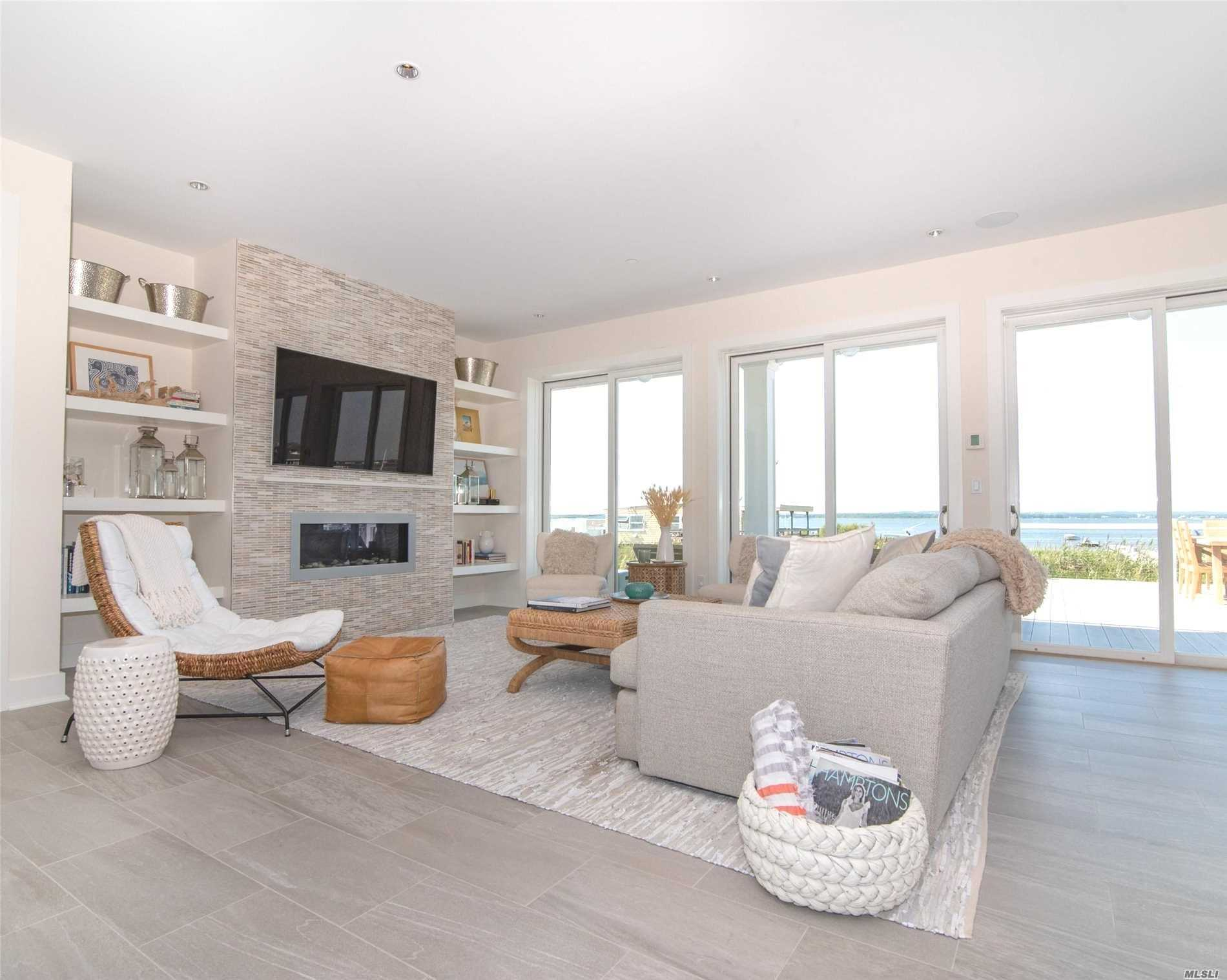 Built In 2014 This 4 Bedroom, 4 Bath Home Has All The Amentities Of A Newly Built Home! Boasts An Open Floor Plan With A Full 3rd Floor Den & Bathroom, Panoramic Ocean & Bay Views And A Relaxing Bayside Infinity Edge Heated Pool. A Deeded Walkway To Both Bay & Ocean Complete The Picture For This Amazing Home!