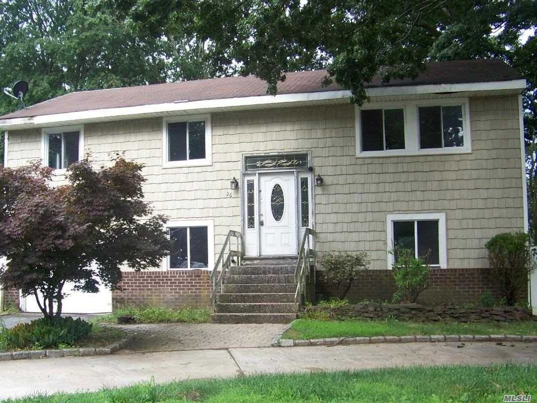 Large Hi Ranch With 4 Bedrooms, 2 Baths, Den And Formal Dining Room. Close To Shopping, Major Roadways And Transportation