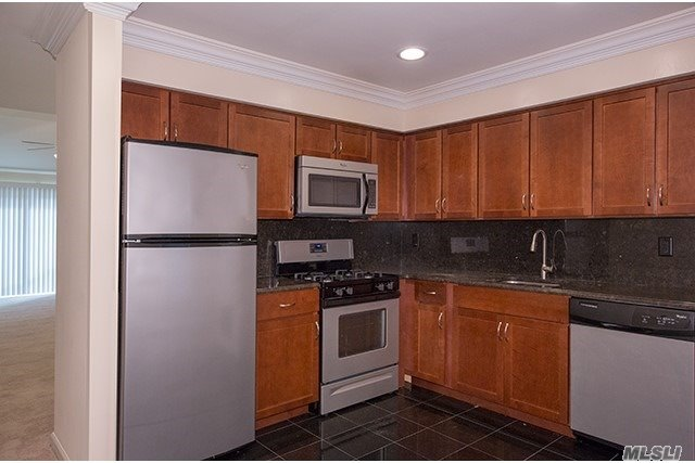 Granite Kitchen Floor/Countertop! Stainless Steel Appliances, Tuscany Cabinets, Hi-Hats, Ceiling Fans, 2-Tone Paint Crn/Base Molding, Carpet. Granite & Marble Bath Vanity Top, Frameless Shower Doors. Central Air, Terr. Free Resident Clubhouse, Fitness, Billiards, Fireplace, Pool, Playground/Barbeque. Laundry Center.