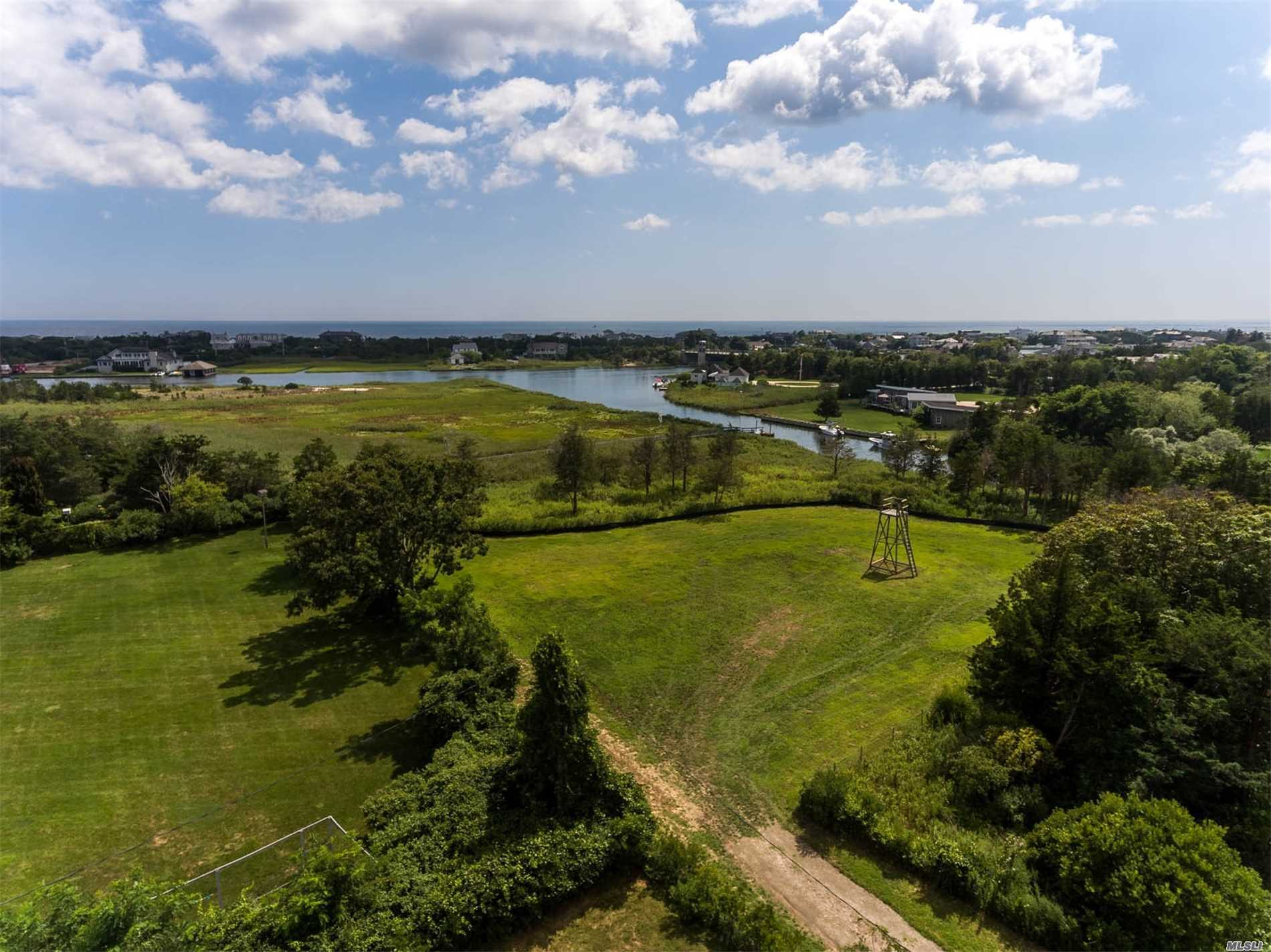 Situated On A Deep Water Canal, 1.5 Acre Parcel Includes Dec & Board Of Health Permits For 5000 Sq. Ft. 2 Story Home With Panoramic Views Including Swimming Pool & Spa, Garage, Deck. Ready To Build Fixed Pier To Protected Boat Dock. Quogue Village Beach Access And Low Taxes. A Very Special Location To Build Your Dream Home!