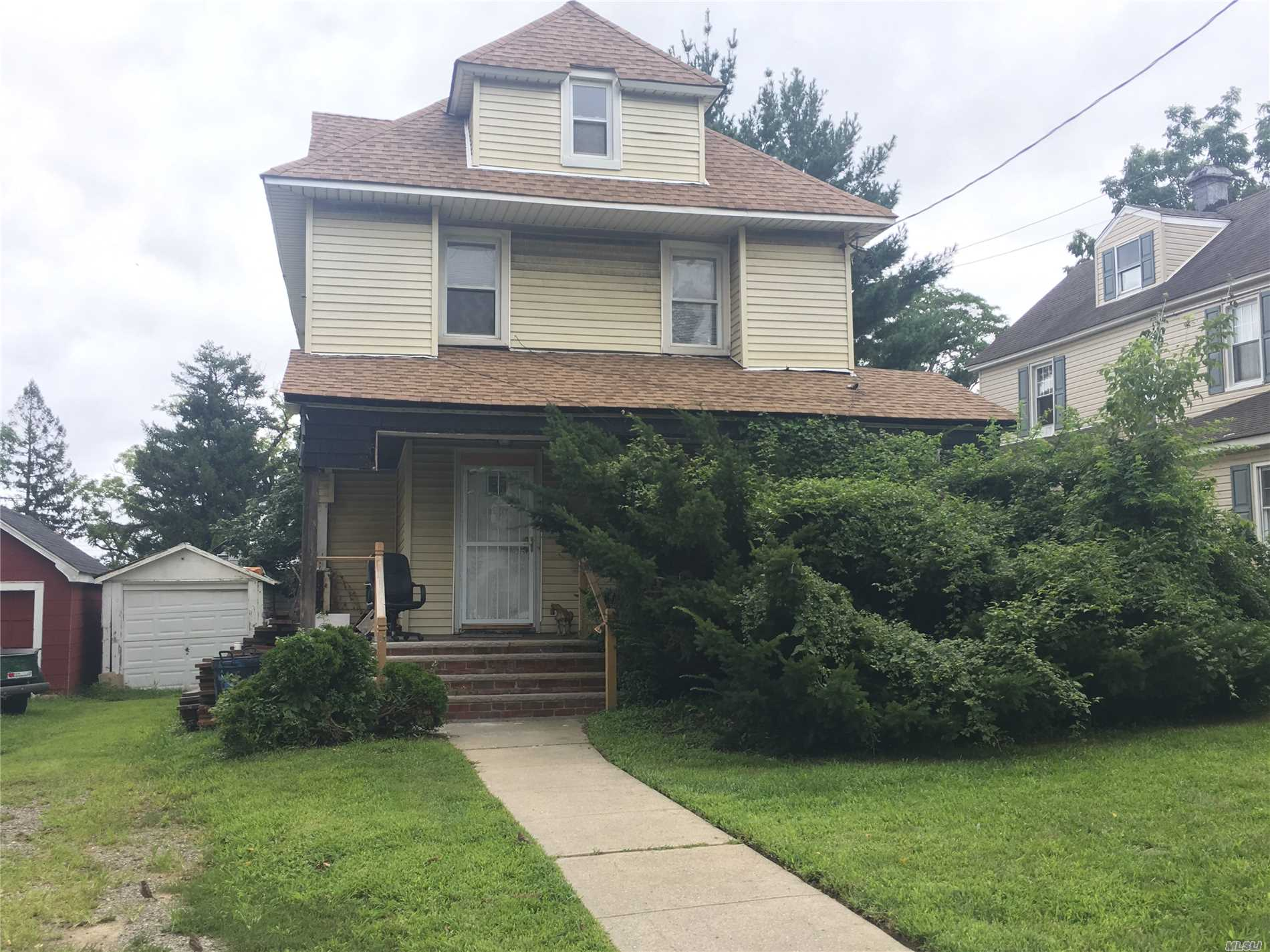 Prime North Bayside Location On 50 X 100 Lot. House Sold As Is. Some Renovations Have Been Done, New Gas Heat Conversion With Tankless Water Heater, Roof Is Aprox 3 Years Old, New Wood Floors Throughout. Complete The Renovation Or Build To Suit.