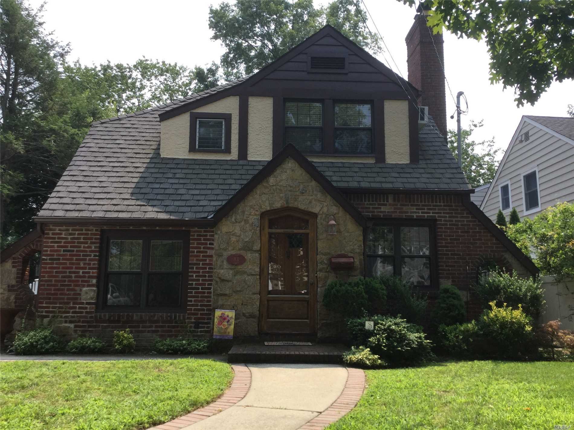Charming Tudor Colonial With Renovated And Expanded Eik, Lr W/ Fireplace, Radiant Heat, Bar Area, Mud Room, Hardwood Floors Throughout, Sliders From Eik To Patio And Fenced Yard. Beautiful Block And Great Curb Appeal. Has Steam And Gas Heat. Won't Last!
