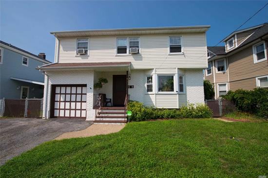 Wow .. Priced To Sell! This Beautiful Well-Maintained 4 Bedroom, 2.5 Bath Colonial Boasts Gleaming Hardwood Floors, Master Ensuite, Gas Heat, 200 Amp Electric, New Hot Water Heater, Ss Appliances, Lg Bedrooms, Full Basement, 1 Car Garage, Den W/Sliders To Private Deck, Fully Fenced In Yard. Close To Shops & Public Transportation. Sd #27. A Must See! Hurry, Won't Last!