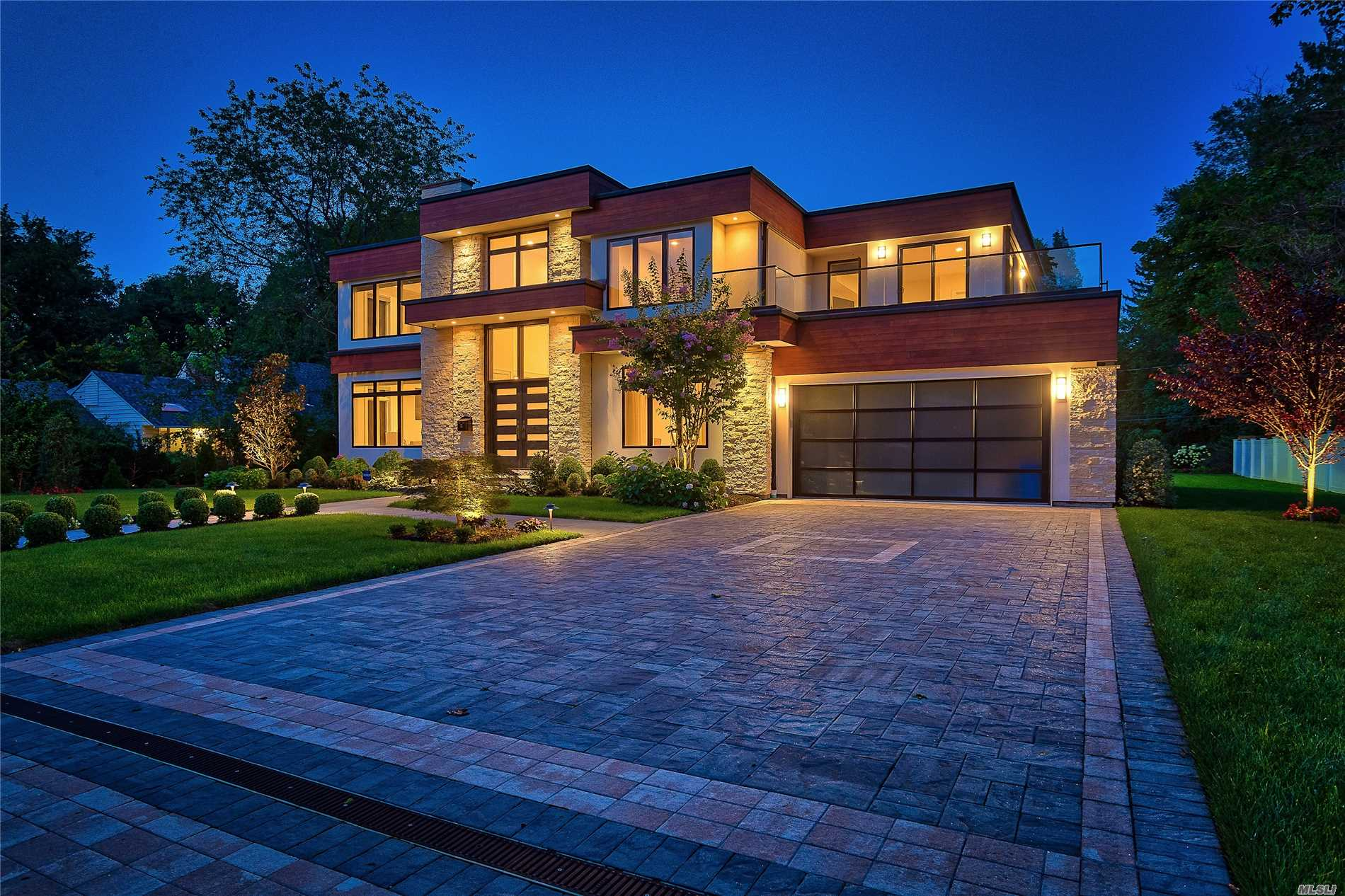 Roslyn Heights. Incredible Contemporary In Roslyn Heights. Peerless Stone & Wood Built, 5-Bedroom, 5.5-Bath Home Sitting On A Third Acre Property. Featuring The Finest In Materials, Remarkable Flow Throughout With Open Layout, Glass & Wood Staircases Leading Upstairs & Downstairs, Radiant Heated Floors, Fabulous Eat In Kitchen With Quarts Counter Tops & Sliding Doors To Back Patio, Finished Basement With Laundry, Theater, Large Recreation Room, Gym, Ose, & Much More!