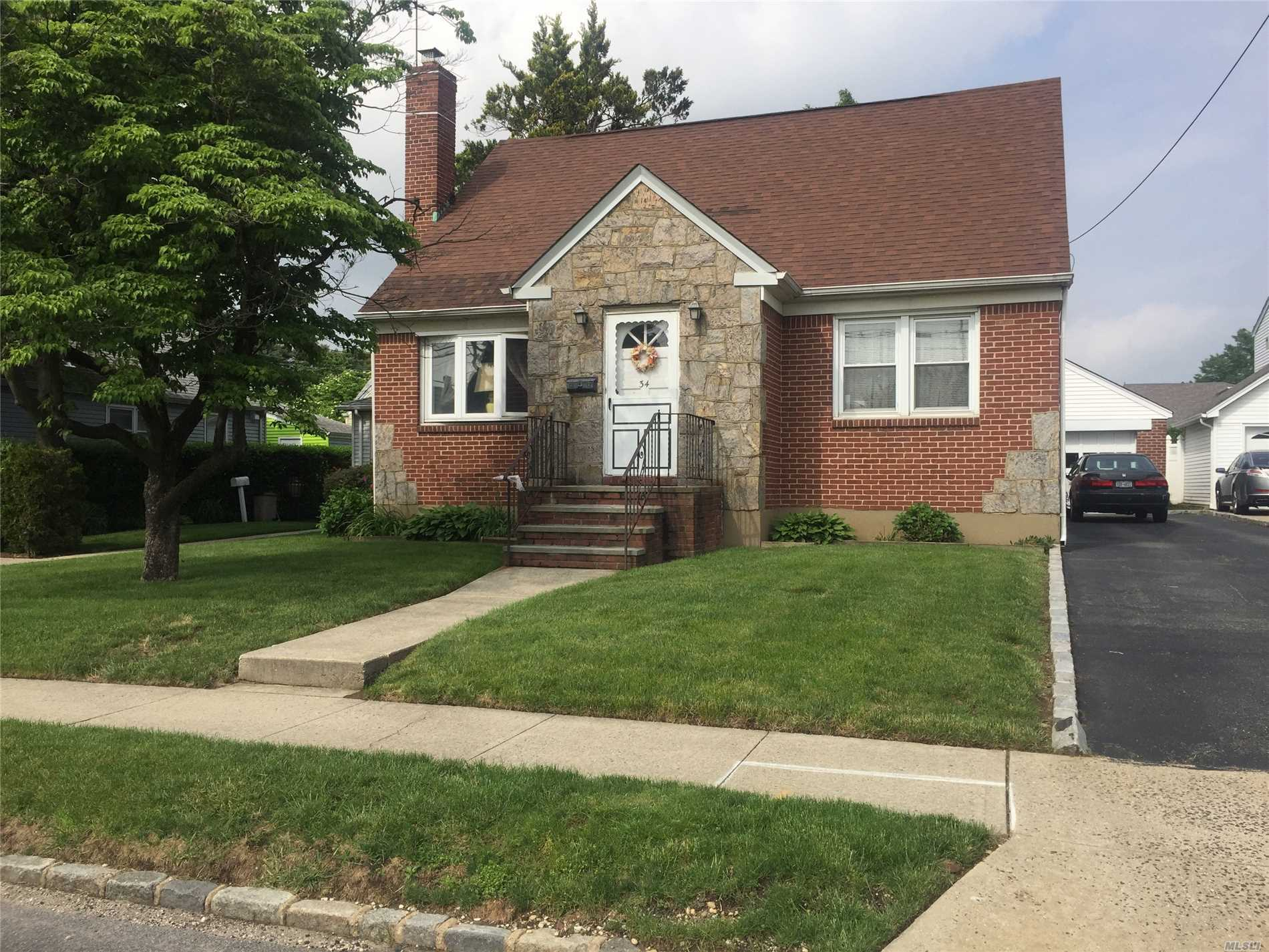 Spacious 4 Bedroom 2 Baths Cape - Rear Dormer 1509 Sq. Ft.- Needs Tlc - Sold As Is - Conveniently Located - Close To Transportation And Schools.