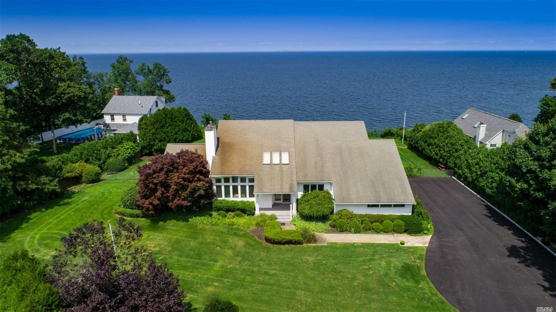 Magnificent Water Front Location W/Breathtaking Views Of The Li Sound. New Pvt Drwy Leading To This Summer Retreat Or Yr Round Paradise. Spectacular Water Views From Every Room W/Oversized Windows/Doors, 1st Fl Mst Ste, Open Fl Plan, Main Fl Laundry, Full Bsmnt, Ose, Take In The Unforgettable Sunsets From The Viewing Deck Or Ig Pool. , Updtd Heat, Cac, New Drwy, Pool Pump, Dishwasher, Micro. Propane Cooking & Fireplace.  Close To Beaches, Farms, Wineries, Shopping, Restaurants. Virtual Tour