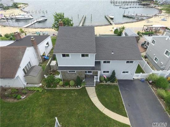 Can't Get Enough Of Those Open Bay Views! Private, Clean Sandy Beach With New Pier & Bay Views, Cozy Florida Room, Converted Garage,  Beautiful Brick Paver Patio, Multi Level Decks, Master Bedrm With Sliders To Deck,  Sharp Black & White Kitchen W/Stainless And Tiled Den W/Skylights With Beautiful Bay Views. Over Sized Property.