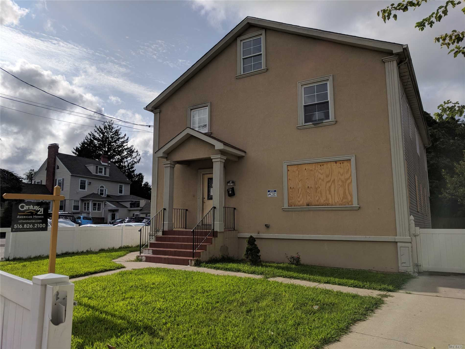 Large & Young Stucco Colonial Right On The Edge Of The Heart Of Hempstead. Everything Is Right At Your Doorstep! Wood Floors, Full Basement, Nice Yard, Lot Of Positive Qualities. Just Needs Some Tlc To Bring It Back To Life!
