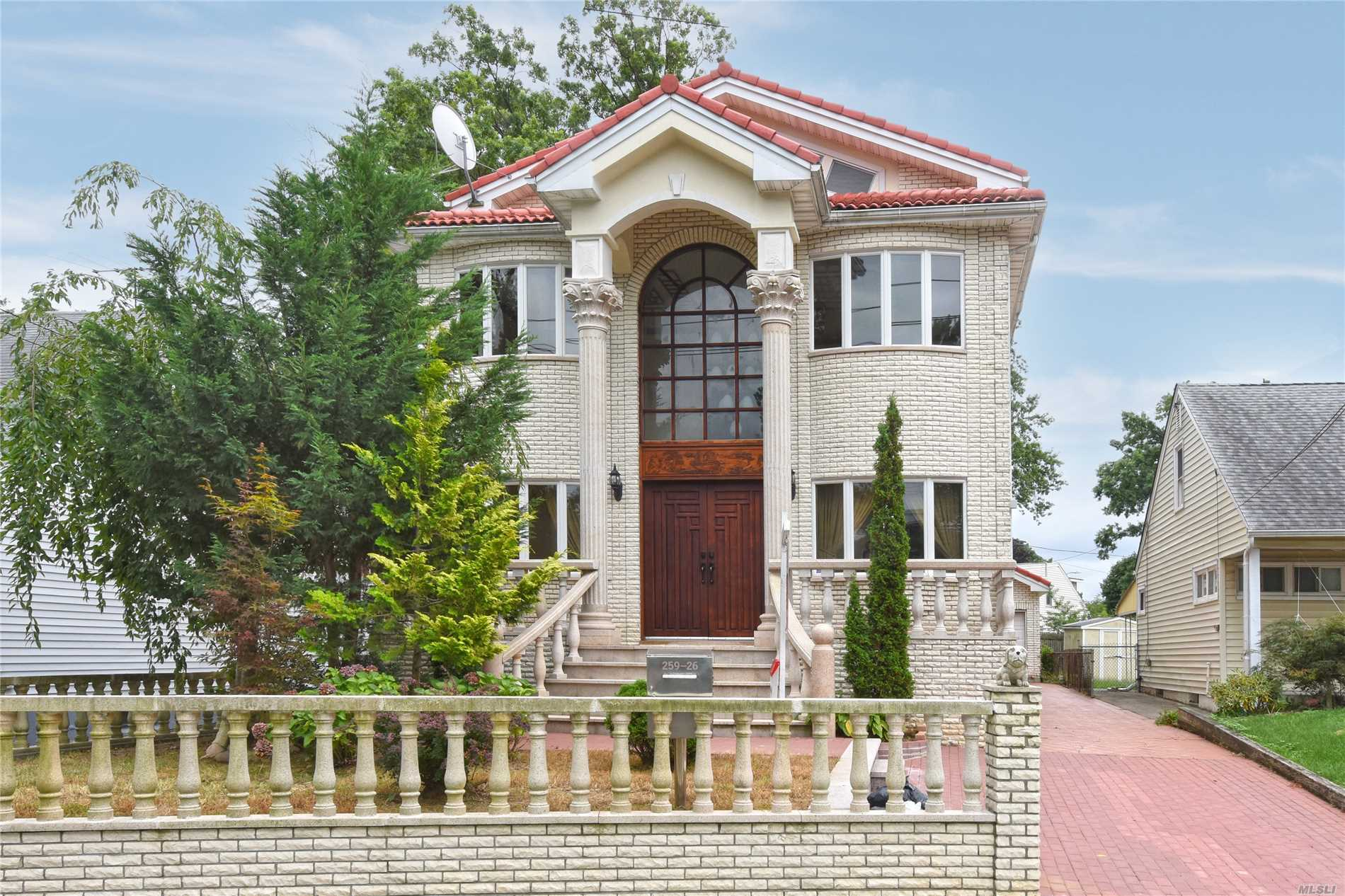 Built With Quality Material! This Regal Custom Rebuilt Features: Grand Entry Foyer W/ Double Height Ceiling, Custom Molding, Cherry Wood Floors, 5 Spacious Bedrooms, 4 Baths & Jacuzzi, Newly Renovated Eat-In Kitchen, Sun-Drenched Loft, High-Ceiling Finished Basement W/Separate Entrance-Perfect Layout For Entertainment! See To Believe! Near-All | School# 26: Ps 221& Jhs 067