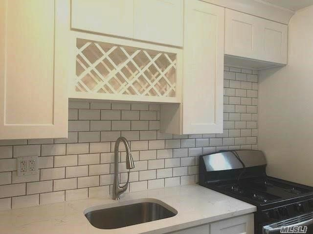 Second Floor Unit -- Pristine One Of A Kind Glen Oaks Rental, New Kitchen With Corian Countertop, New Bathroom, Hardwood Floors Throughout, Full Steps To A Full Finished Attic Which Can Be Used For Office, Close To All Transportation To Nyc, Express Bus, Lirr & Bus To Subway. Move In Ready!