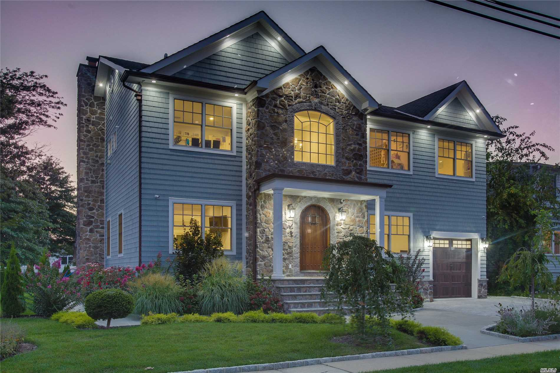 Luxury Is Redefined In This 3, 600 Sq. Ft. Custom Built Home In Wantagh's Mandalay Bay Community. High-End Kitchen, Master Suite W/ Private Terrace, Huge Bathroom, Walk-In Closets & Private Home Office. Large Family & Living Room W/ Wood Burning Fireplace, Crown Moldings & Coffered Ceilings In Formal Dining Room. Custom Landscape Lighting, Spacious Backyard W/ Elegant Finishes.