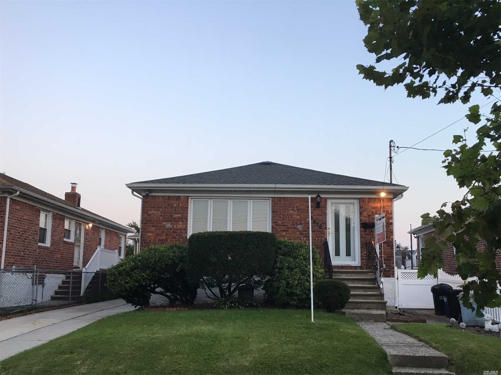 Mint Condition Brick Low Ranch Home Located In Old Howard Beach, Brand New Kitchen, Brand New Flooring Living Room And Dining Room, New Roof, Newly Cemented Driveway, New Finished Basement, Central Air Conditioning Throughout High Efficiency Boiler. Nice Fenced In Yard 2 Blocks To Charles Park.