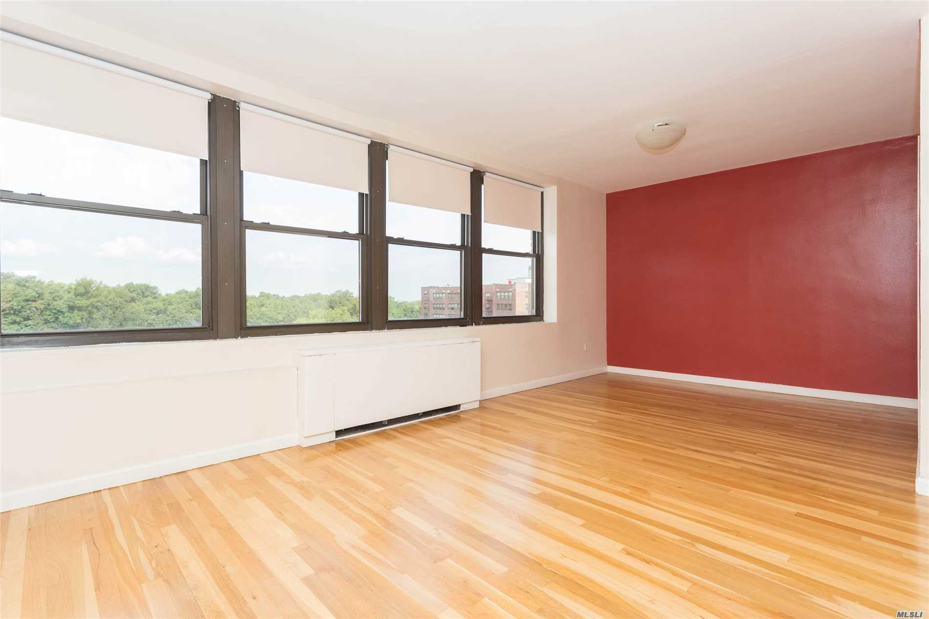 Sunfilled And Oversized 950 Sq. Ft. 1 Bedroom With Separate Dining Area Which Can Be Used As A Small Second Bedroom/Den. Updated Eat In Kitchen And Bathroom, Central Air/ Heat, Plus Indoor Garage Ownership. Walk To Bay Terrace Shops, Express Bus To City Right Outside Your Door. Great Location. Don't Pass This By!