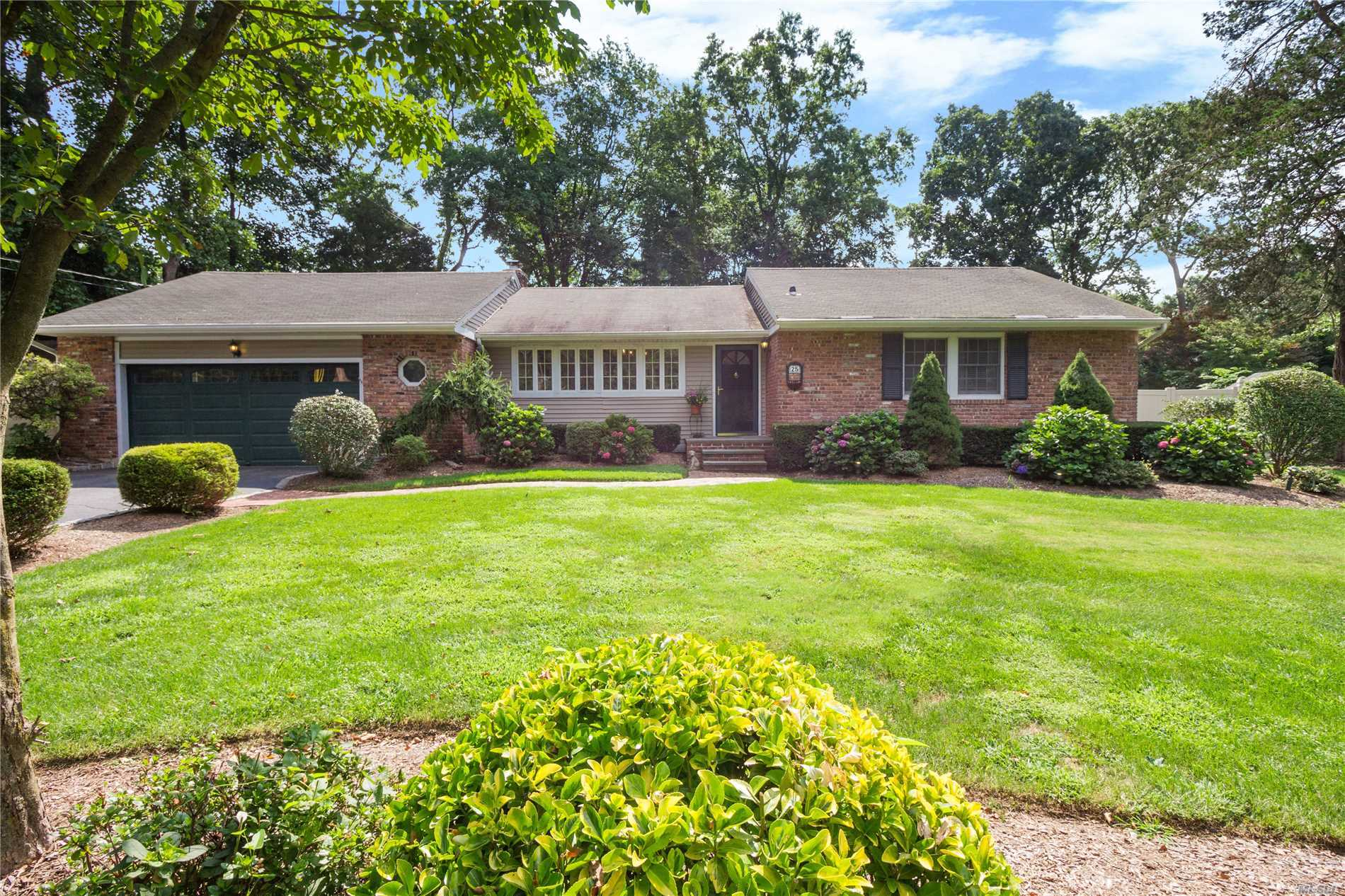 Easy Living In This 4 Bedroom, 2 Full Bath Brick Ranch. Granite/Stainless Kitchen, Soaring Ceilings And Walls Of Glass Overlooking Flat Manicured .56 Acre Fully Fenced Yard. Light Bright Family Room And Spacious 4 Bedrooms Make This House Ideal. Minutes To The Train, Huntington Village And Beaches. Flower Hill Elementary. Taxes W/ Star $13, 18.