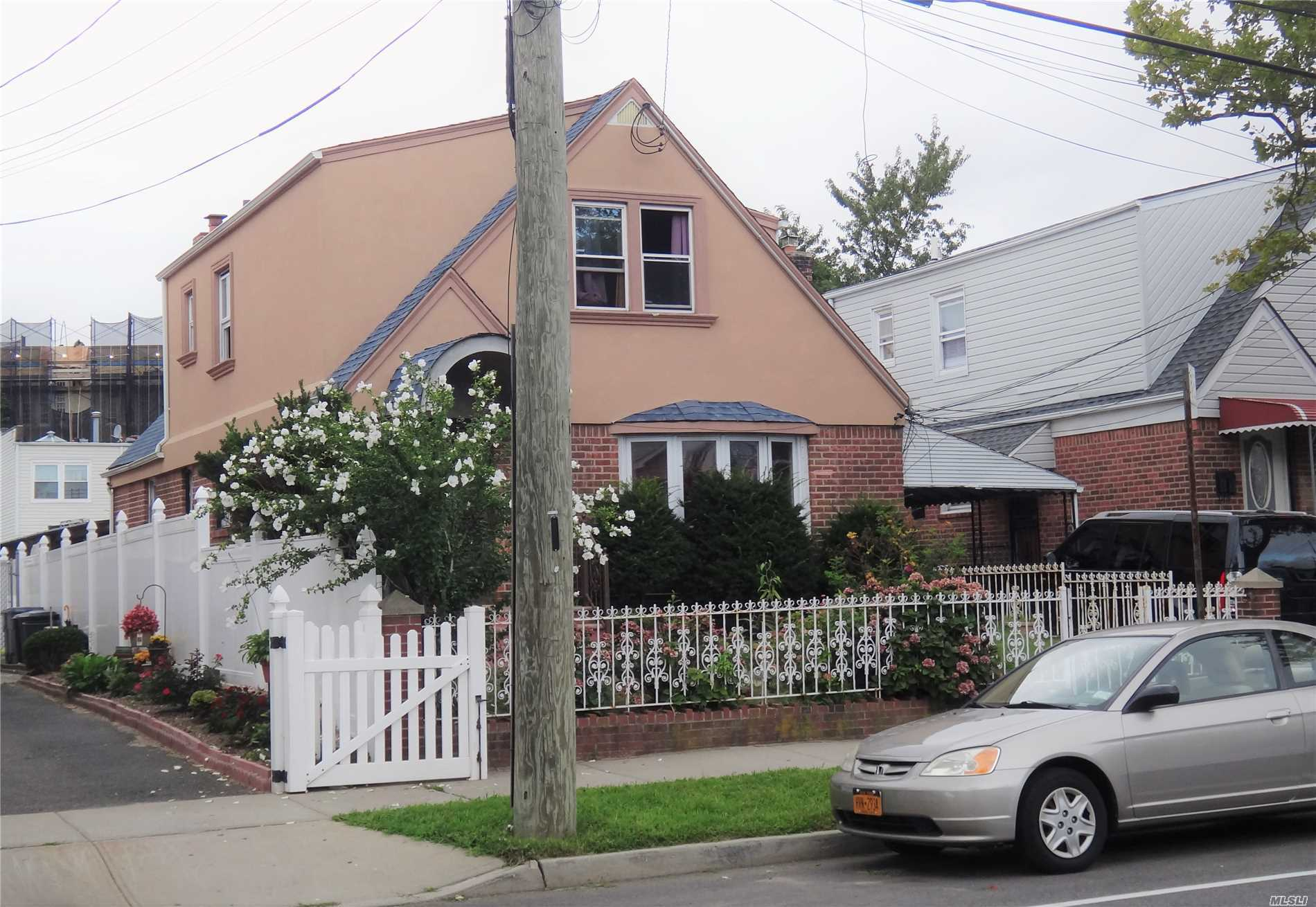 Huge Two Family In Quite Community Featuring Nice Sized Rooms, Hardwood Flooring On All Levels, Huge Full Finished Basement With Laundry Room And A Large Private Driveway That Leads To A Secured Oversized Backyard. Totally Vacant Upon Closing Of Title.