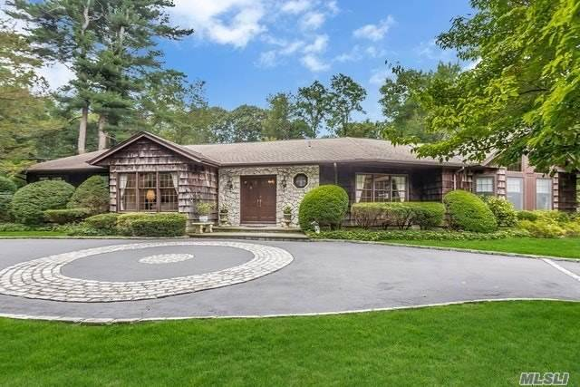 Your Own Private Oasis; An Expanded 5Br, 3.55 Bath Ranch W/Guest Wing For Extended Family Sitting On 2 Plush Professional Landscape Acres W/Waterall & Fish Pond. Semi-Open Floor Plan For Entertaining, Hardwood Floors Thruout, Cac, Sunroom, Bluestone Patio, Circular Driveway. Much More! Locust Valley Schools.