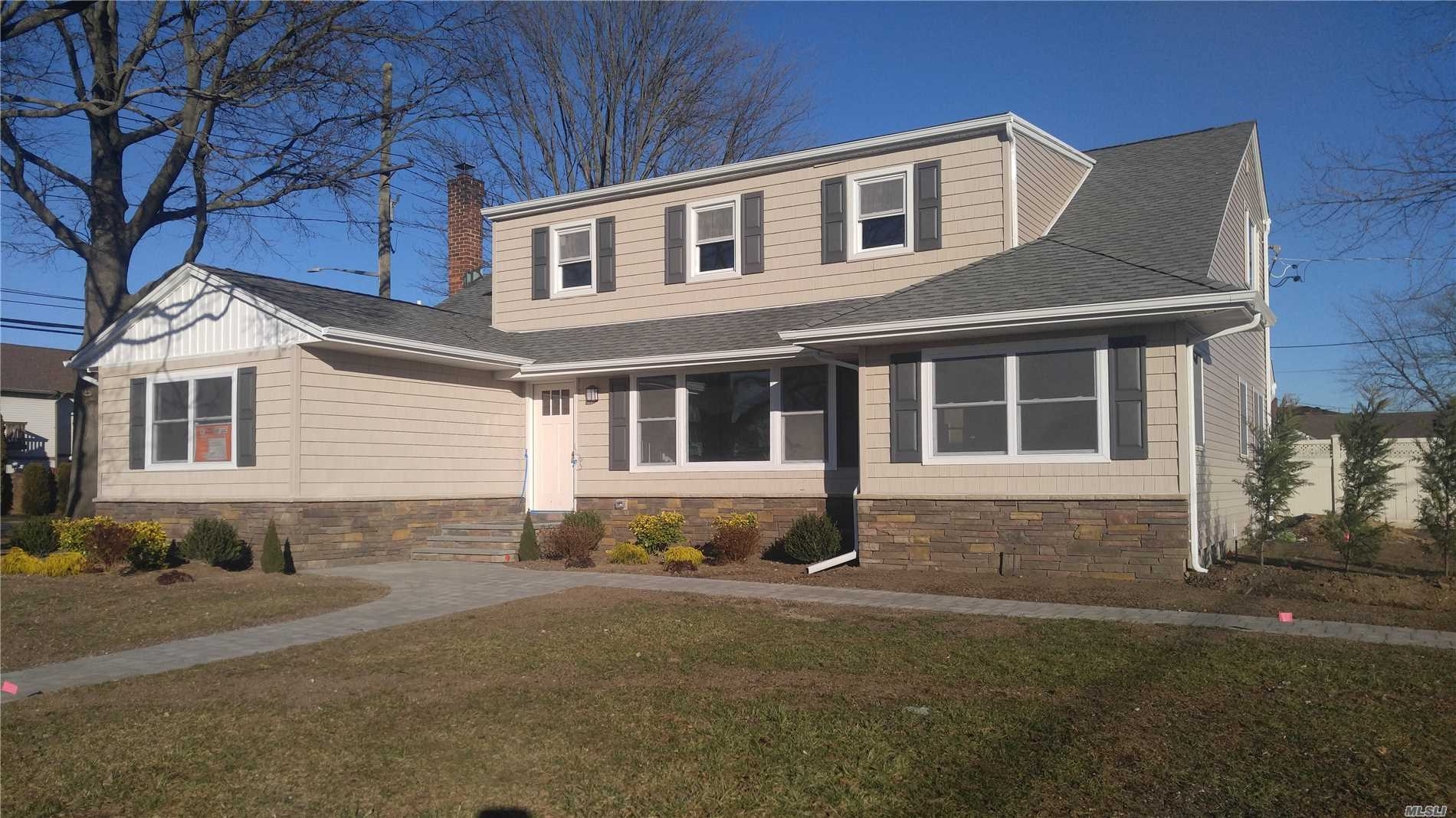 Large Colonial Totally Redone From Top To Bottom Zoning For Commercial Use, Live And Work From Your Own Home Or Bring Family Members Open Floor Plan, Master Suite On First Floor And Second Floor, Beautiful New Kitchen With Large Island And Granite Counter Tops, Stainless Steel Appliances, Hardwood Throughout, New 200 Amp Electric, New Gas Hydronic Heating System, Full Finished Basement, 30Ft Patio Pavers, New Siding, , Many Option, Act Now Maybe Time To Pick Your Own Colors Photos Used For Similarity Only
