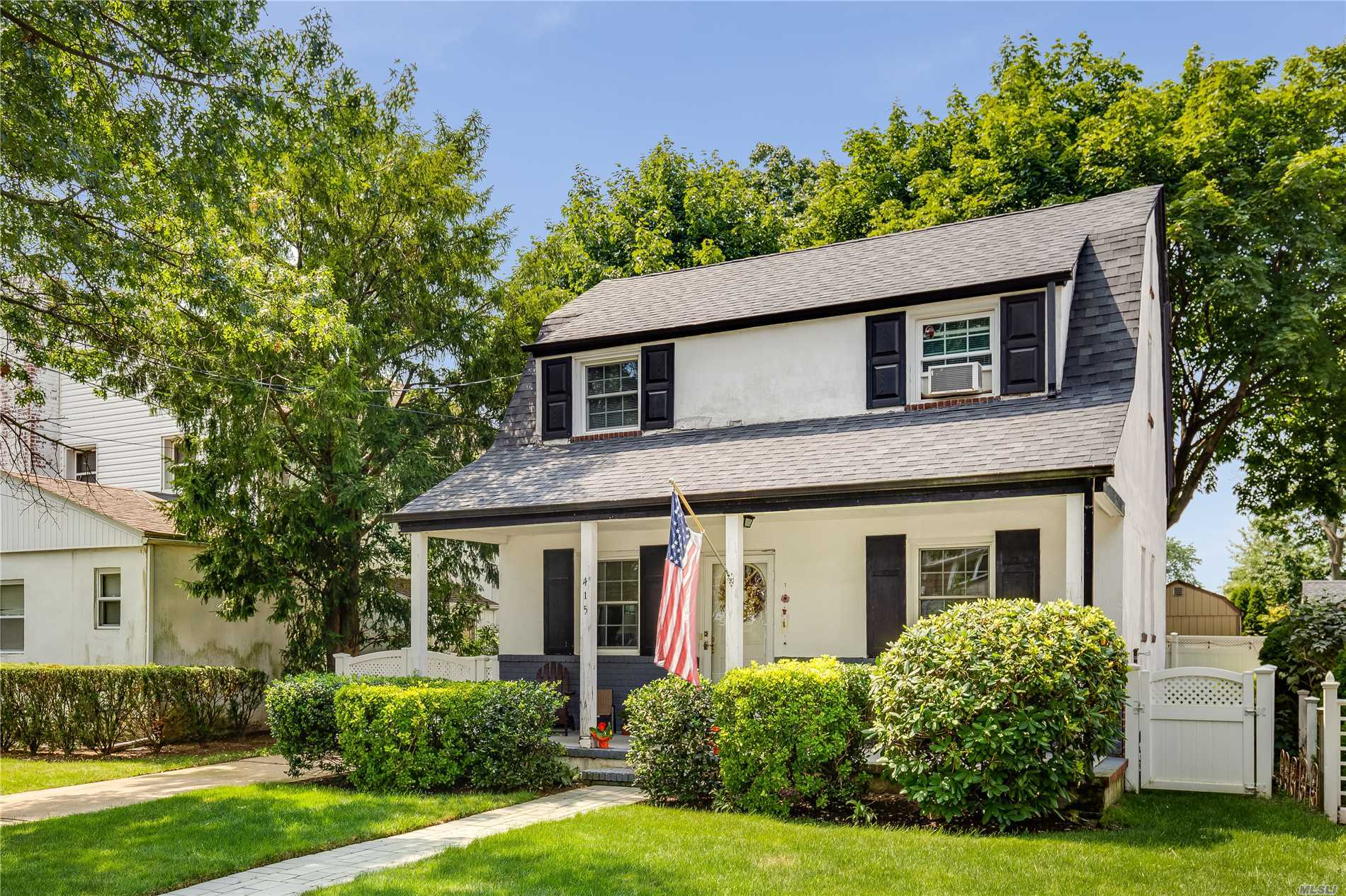 Lovely Colonial With Front Porch In The Heart Of New Hyde Park. Hardwood Floors. Newer Therma Pane Windows. Newer Roof And Fence. Updated Bathroom. Updated Electric. Private Backyard. Newer Front Paver Walkway. In Ground Sprinklers. One Car Garage. Walk To Schools And Lirr