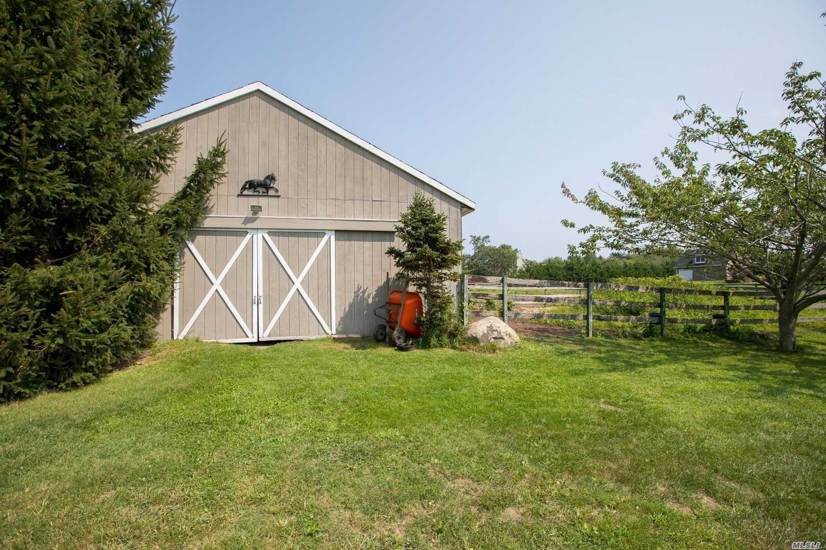 Beautiful 2.59 Acres In Bucolic Southold With 3 Outbuildings Including A 30'X 36' Barn With 3 Stalls, Fencing And Bonus Lovely 3 Bedroom Home! Relaxed Country Setting With Huge Deck For Entertaining, Room For Your Animals, Gardens, Pool, Tennis And More! A Wonderful Foundation For Your North Fork Dreams.