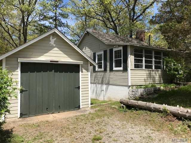 And Located On Dead End Street With Privacy, Cement Patio With Covered Eating Area. Yard Backs To Nature Preserve. Walk To Beach. Detached Garage With Storage!