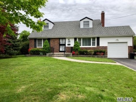 4 Bedroom, 2 Bath Expanded Cape In Elwood School District.L/R W/Beautiful Stone Fireplace, Hardwood Flrs Thru-Out Inc 2nd Flr, Open Kit/Dining, 2nd Flr Has 2 Nice Size Bedrms W/Walk-In Closets, Spacious Backyard, Perfect For Fun & Entertaining.Great Opportunity To Live In The Award Winning Elwood Sd & East Northport..