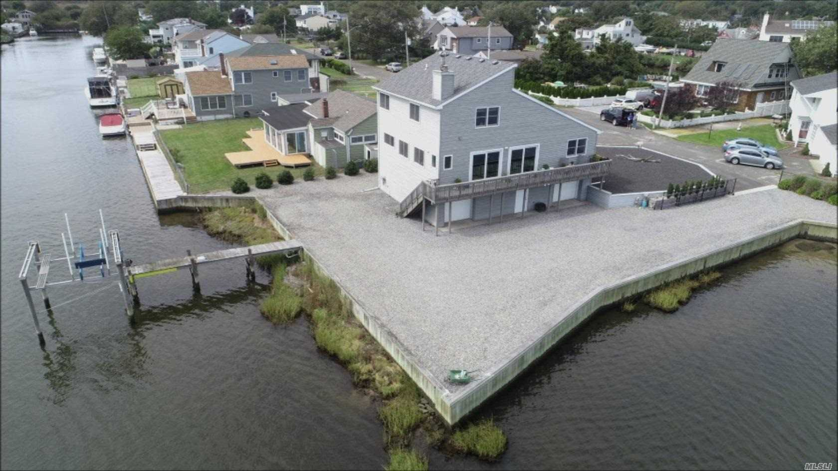 Wake Up Everyday To Unobstructed Views Of The Great South Bay, Open Floor Plan Views From Every Room, 255 Feet Of Bulkhead With A 30' Pier And Boat Lift. Enjoy Sunrises And Sunsets In This Elegant Open And Airy Layout, 200 Amp Service, Central Vac, Two 275Gal Oil Tanks, Superb Quality And Just Remodeled.
