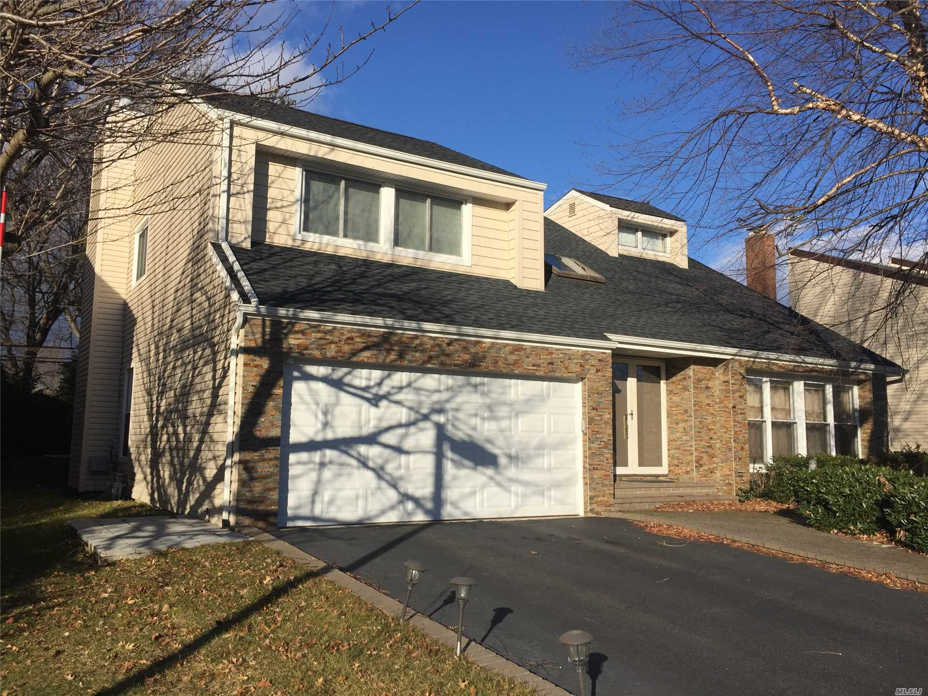 Located In The Desirable Campus Estates Section Of Syosset, Country Club Living W/ Community Pool & Tennis, Updated & Renovated Beautiful Colonial On Oversized Lot, Spacious Rooms, Soaring Ceiling, Formal Living Room& Dining Room, Family Room W/Fireplace Opens To Large Eik, A Large Yard With Rear Deck. New Windows & Roof & Siding Installed In 2017. Alarm System W/Cameras. Garage Equipped W/Charging Outlet For Electric Car. Syosset Sd, Robbins Lane Elementary School & H B Thompson Middle School.