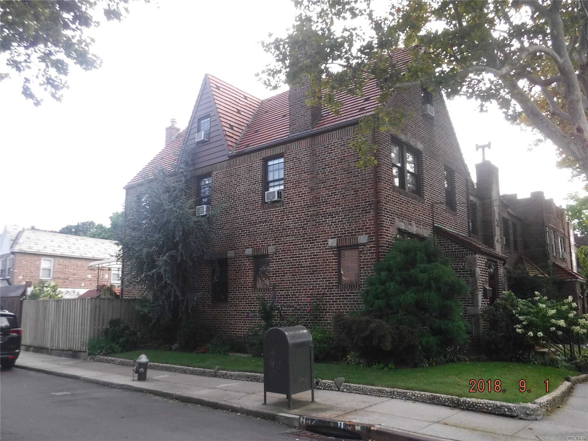 Charming Well Kept 2 Families Tudor. Sprinkle System In Front And Side Yard. Renovated Main Bathroom With Separate Shower And Jacuzzi. Corner Property With 2 Cars Garage + Parking Space In Driveway. Third Floor Studio Apartment With Terrace. Two Working Fire Wood Burning Fireplaces.