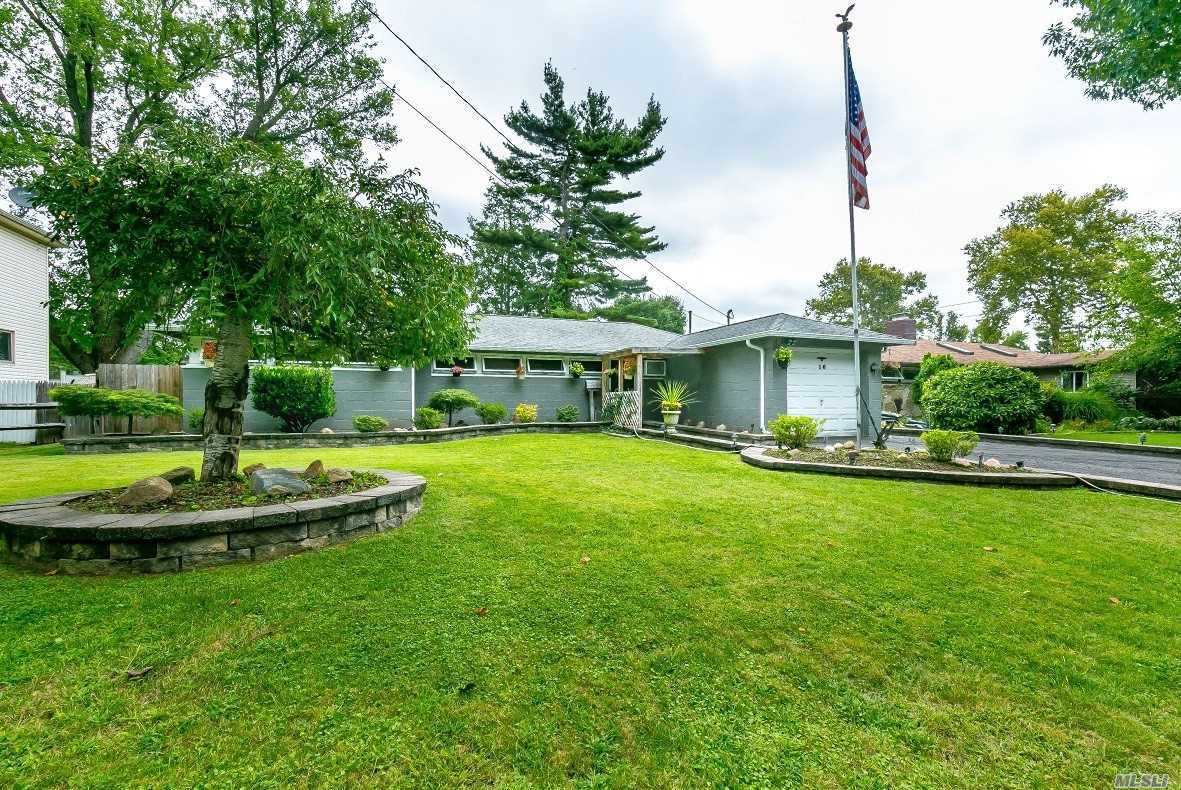 Sparkling Gem! Open Layout, Move-In Condition, Beautifully Set On Professionally Landscaped Property, Above Ground Pool. Quiet Street. Convenient Location. Roslyn School District, Low Taxes. Priced To Sell. Partial Garage Conversion.