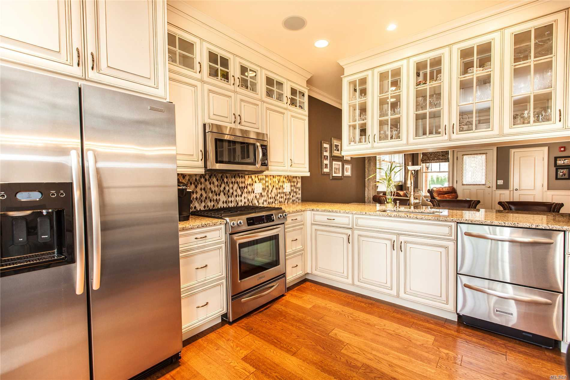 Gorgeous Georgetown Villa W/ Designer Finishes Throughout. All Floors 5 Oak Wood, 5 Crown Moldings, Custom Kitchen W/ Floating Cabinet Above Granite Counter, Custom Closet Cabinetry W/ Lighting, Custom Window Treatments, Custom Raised Panel Walls In Kitchen, Bathroom, Hallway & Upstairs Den. Upgraded 2 Zone Heat/Hvac W/ Added Electrostatic Filter In Addition To Regular Filter & Humidifier, Hot Water Circulation, Laundry Room, Attached Garage & Patio.